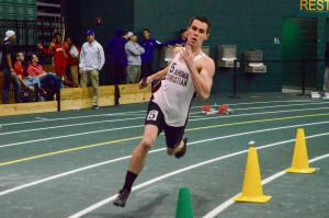Josh Jones runs his leg of the record-breaking 4x400-meter team on Feb. 13. Photo by Katie Jones.