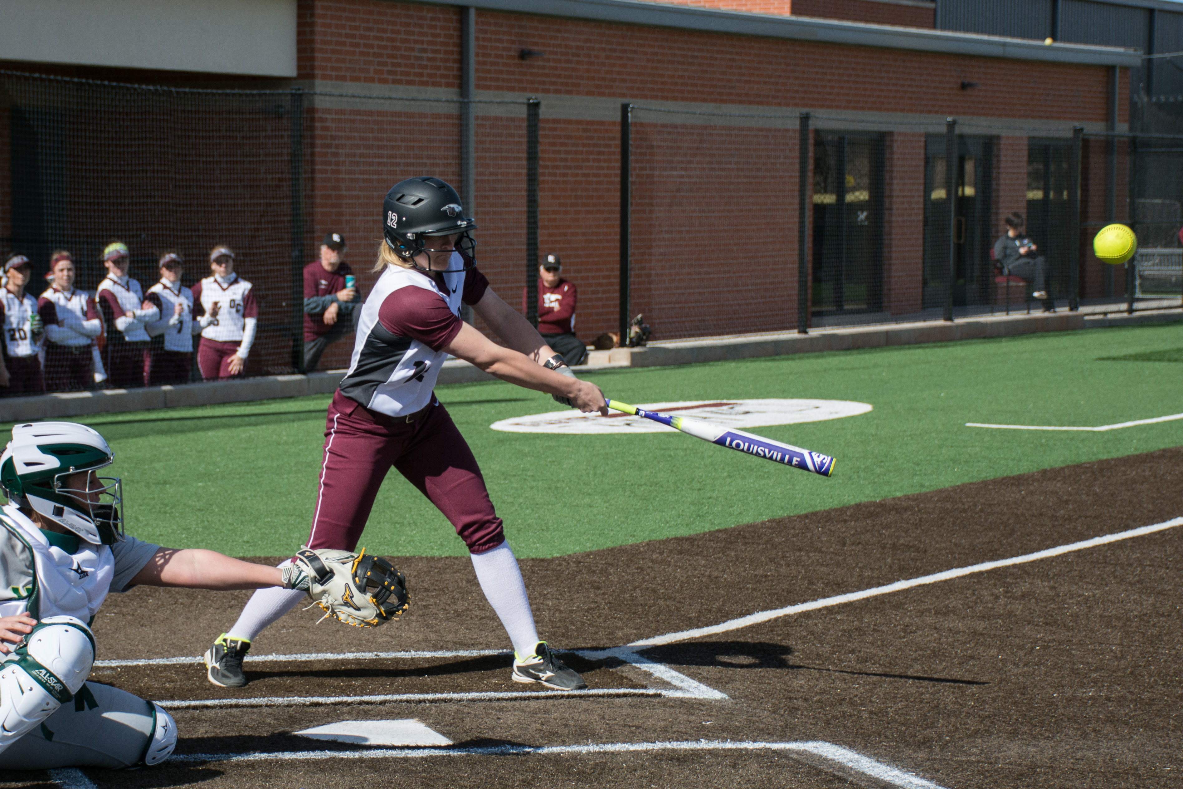 Avery Walker connects with the ball during the team's doubleheader against USAO on Feb. 16. Photo by Abby Bellow.