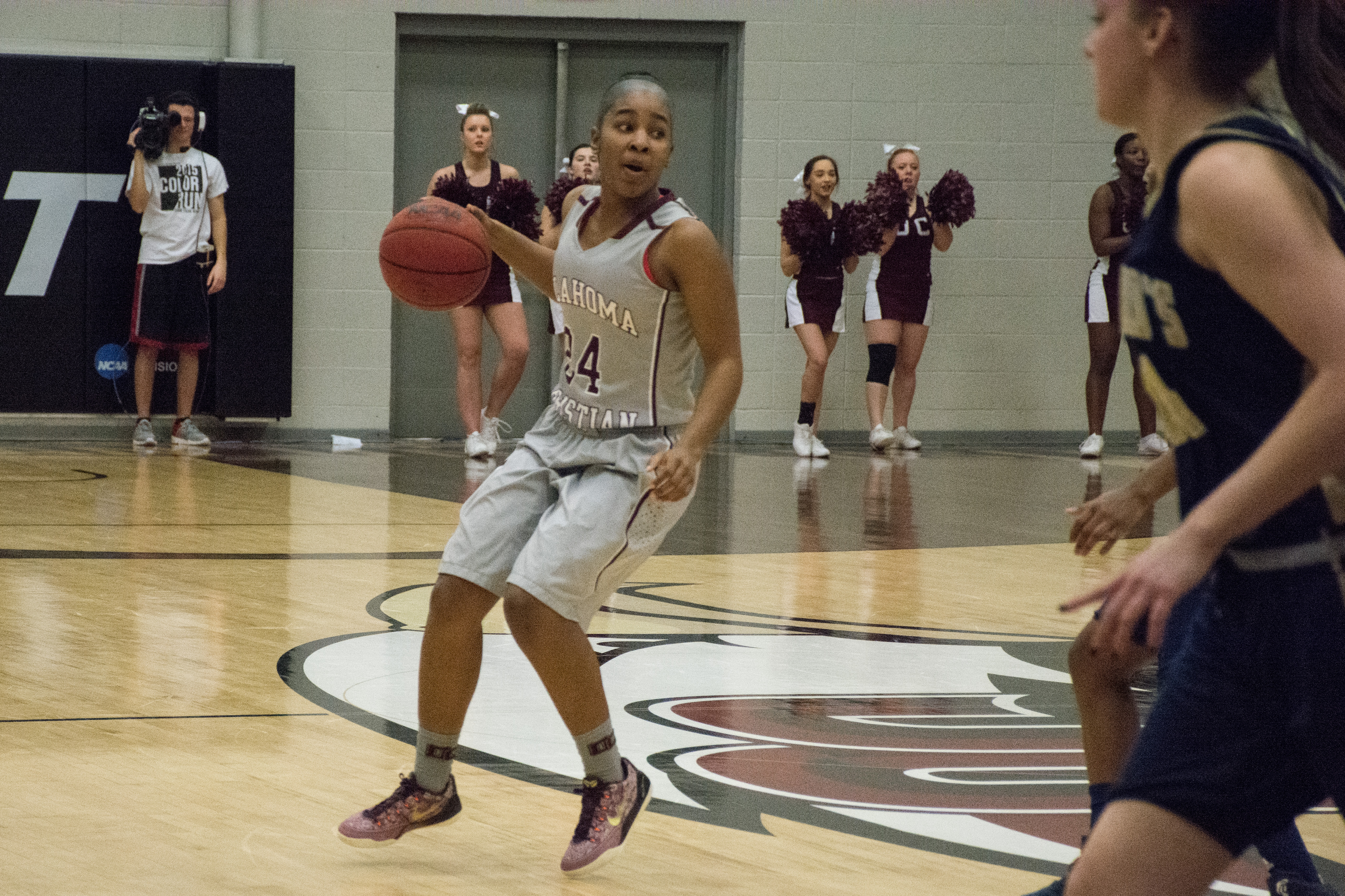 Daisha Gonzaque sets up a play as the Lady Eagles battled St. Edward's on Feb. 25. Photo by Abby Bellow.