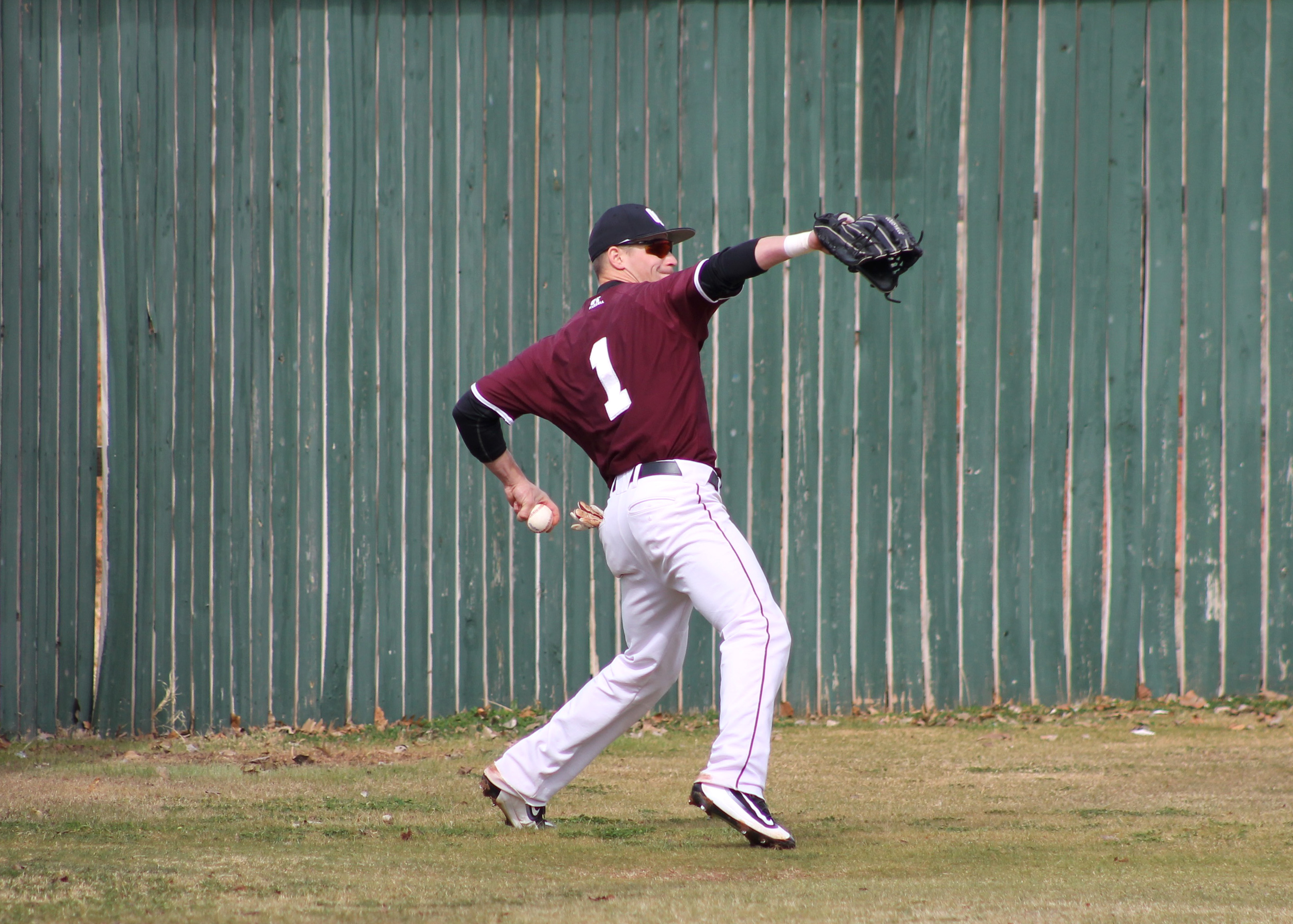 Kyle Lacy throws a hit infield in the game against West Texas A&M on Feb. 26-27. Photo by Allyson Hazelrigg.
