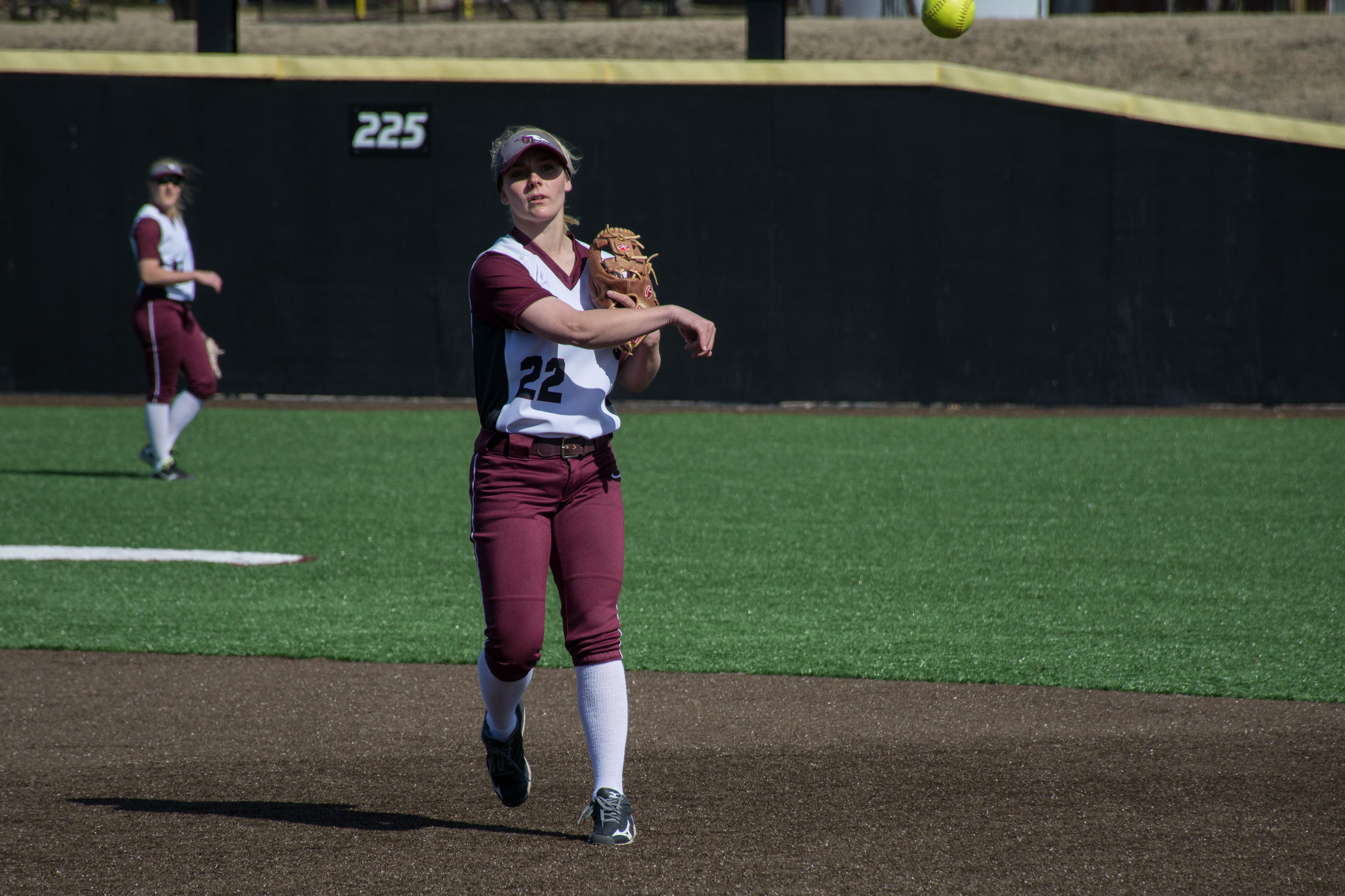 Sheridan Bond continues a play during the March 30 doubleheader Midwestern State. Photo by Abby Bellow.