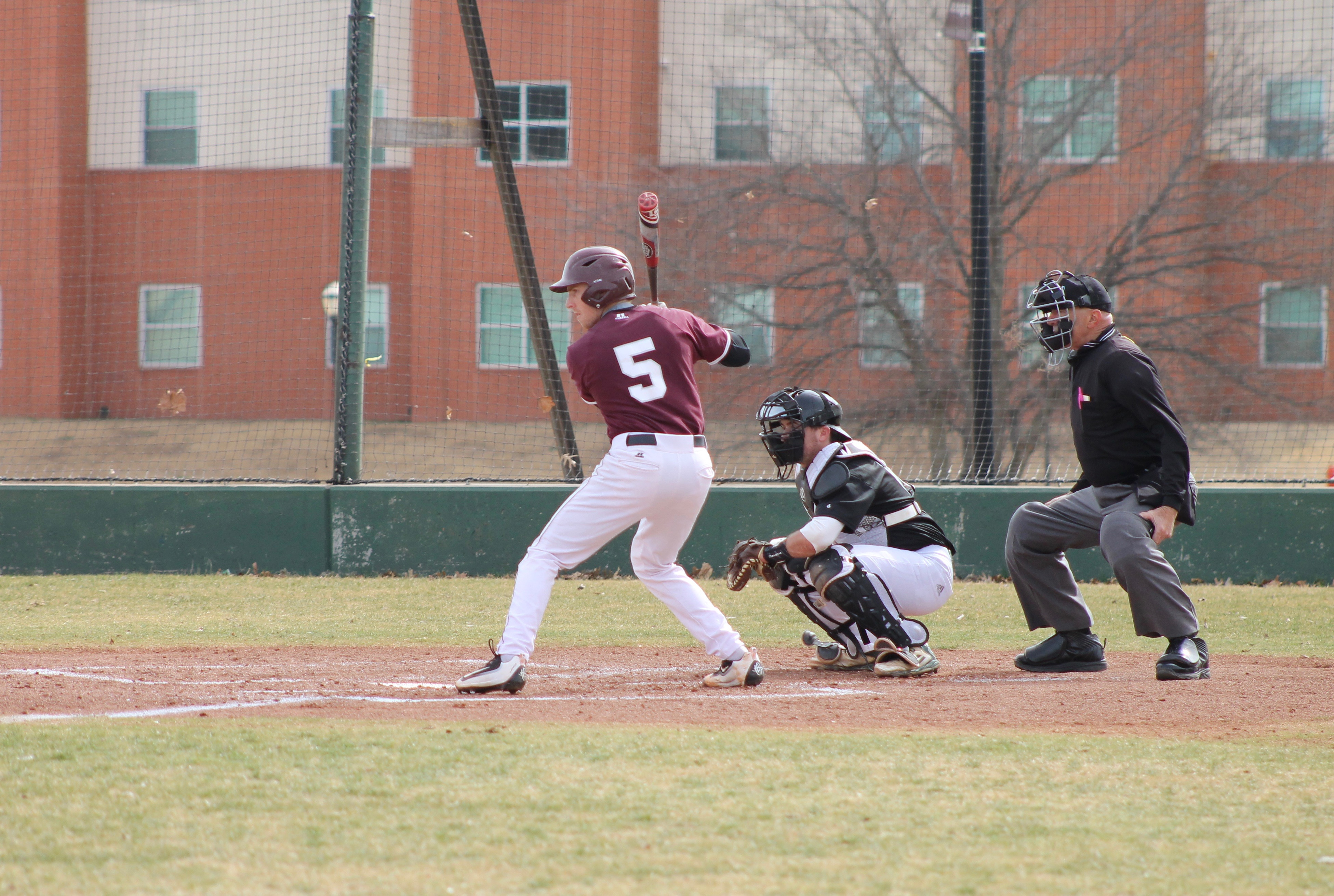 Chase Kuwitzky prepares for the pitch by Southwestern Oklahoma State on March 29. Photo by Allyson Hazelrigg.