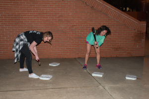 """Students smashed scales with hammers to """"free"""" themselves from bad self-image. Photo by Abby Bellow"""