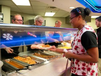 Faculty and staff serve students the first day of finals week every semester for late-night breakfast. Online photo
