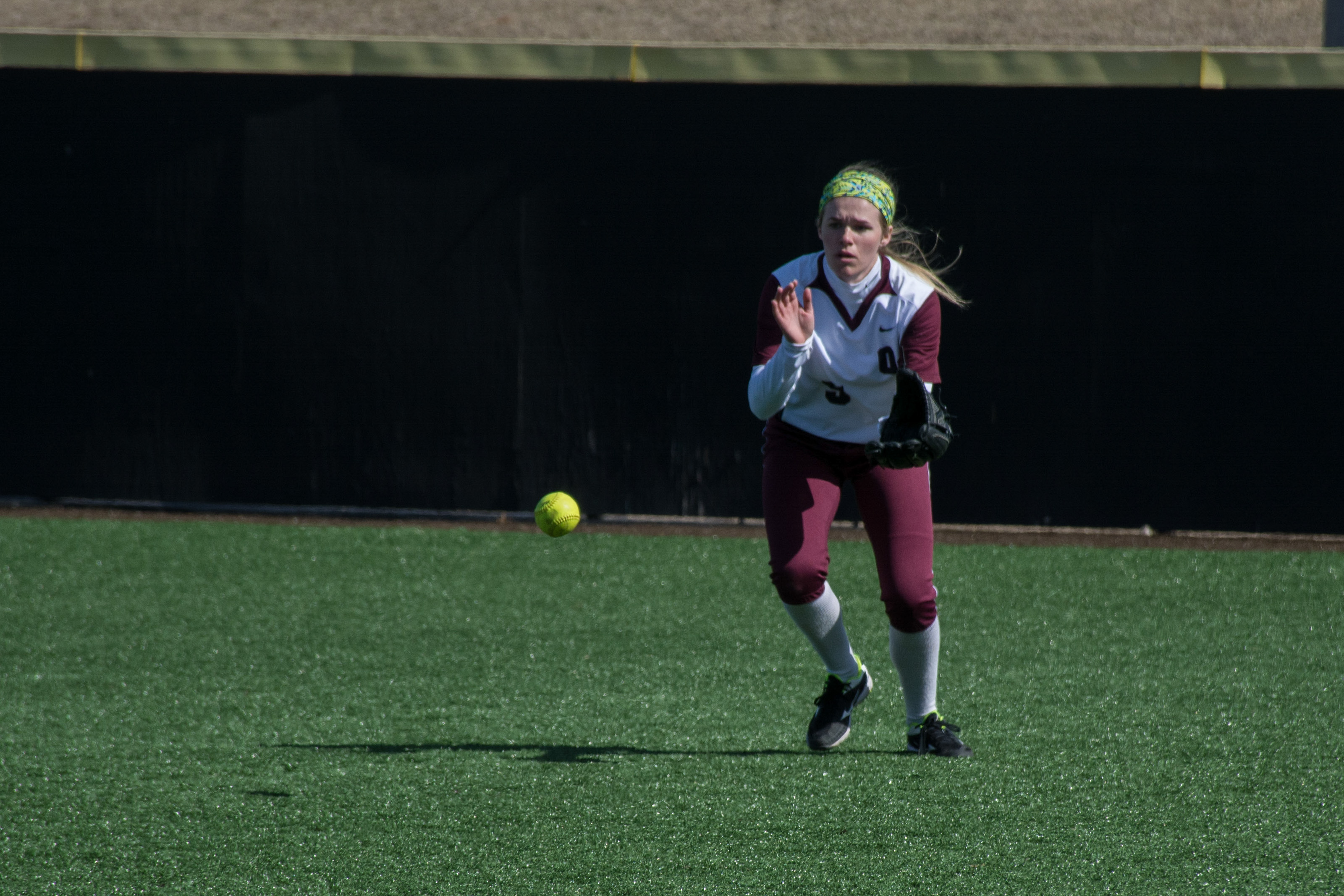 Haley Squier prepares to receive Fort Hays' hit on April 12. Photo by Abby Bellow.