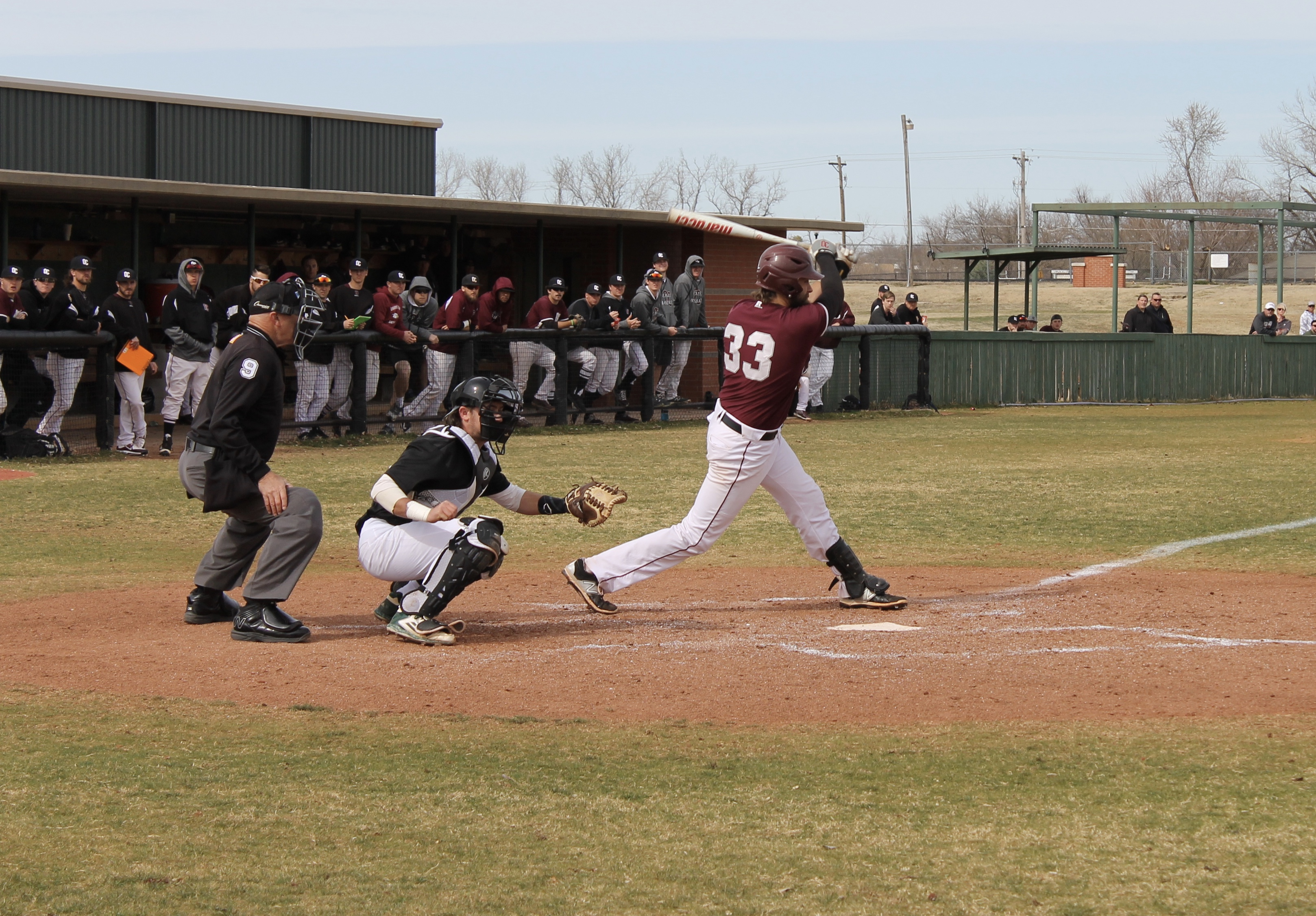Jake Baxter follows his hit against Southern Nazarene on April 5. Photo by Allyson Hazelrigg.