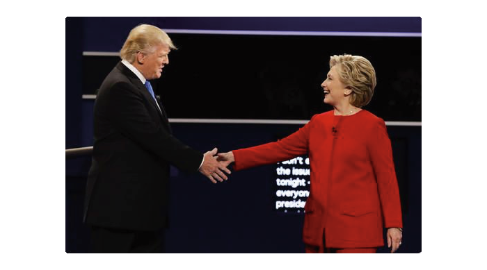 Republican nominee Donald Trump shakes hands with Democratic nominee Hillary Clinton at last nights debate. Online photo.