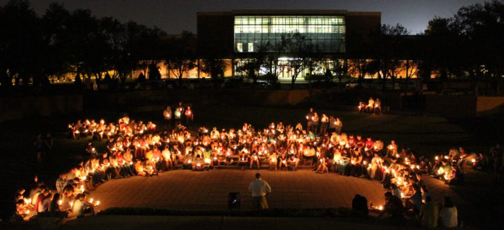 Students and faculty gather for the candle lighting on World Suicide Prevention Day. Photo by Jenny Rigney.