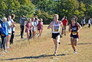 Kelton Reynolds sprints toward the finish line at the Fort Hays State Tiger Open on Oct. 8. Photo by Katie Jones.