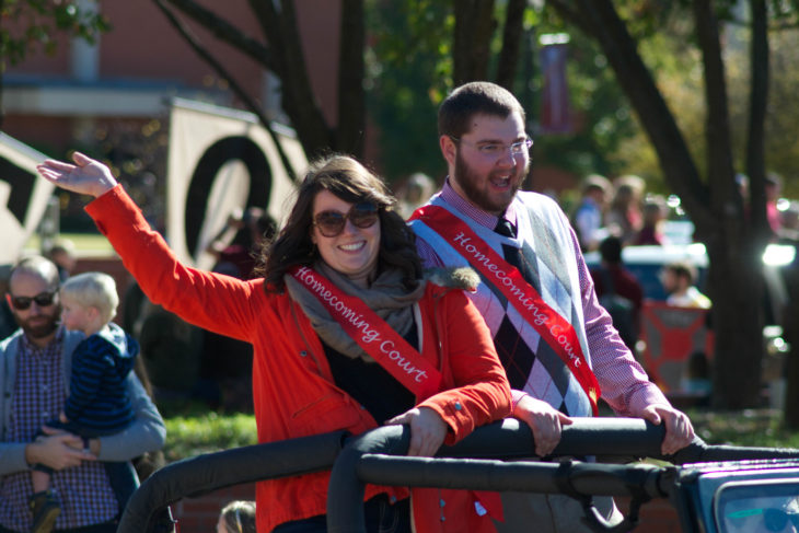 Homecoming king and queen candidates from 2015 start off the annual parade. Online Photo.