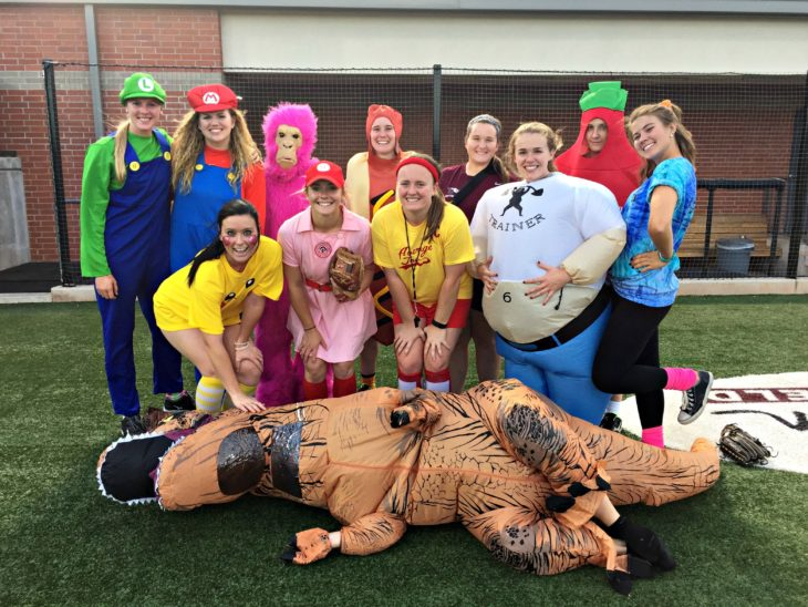 OC women's softball team in costume at the game on Monday night. Submitted photo.