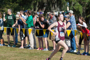 Layne Hammer competing in her final cross country season. Photo by The Sports Information Office.
