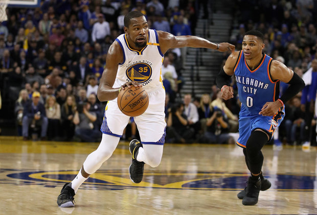 Kevin Durant dribbles past Russell Westbrook in Oakland, California. Photo from OregonLive.com.