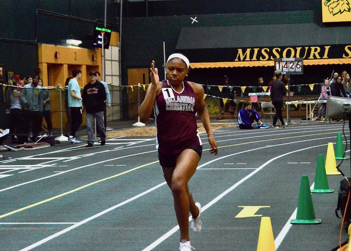 Freshman Allegra Sloan finishes out her leg of the relay. Photo by Katie Jones.
