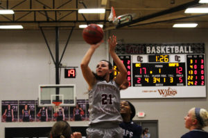 Number 21 McKenzie Stanford finished her final season with Oklahoma Christian. Photo by Jenny Rigney