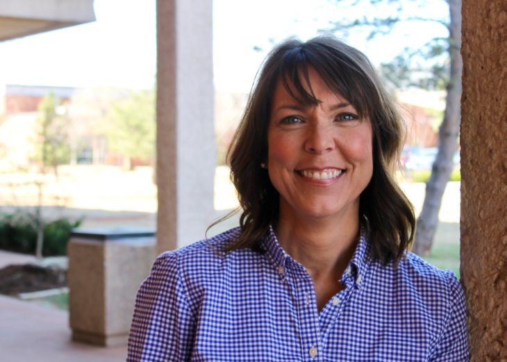 Amy Gower works in the Welcome Center at Oklahoma Christian University. Photo by Allyson Hazelrigg.