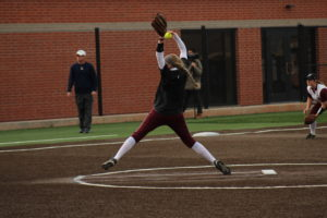 Sophomore Kaylie Upton throws a pitch. Photo by Jenny Rigney.