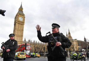 Police push people back following a terror attack outside Parliament in London on March 22. Photo from NBC.com.