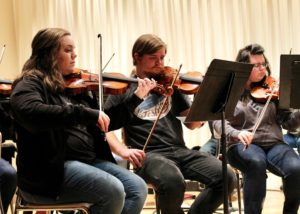The orchestra prepares to end their semester in tune. Photo by Allyson Hazelrigg.