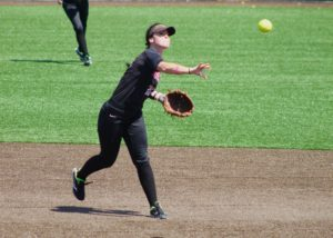 Lacey Davidson throws the ball to first base. Photo by Allyson Hazelrigg.