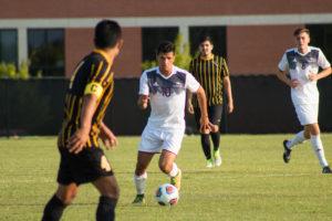 Junior Matheus Mantovani dribbles the ball up the field against Oklahoma Baptist Thursday night. Photo by Jenny Rigney.