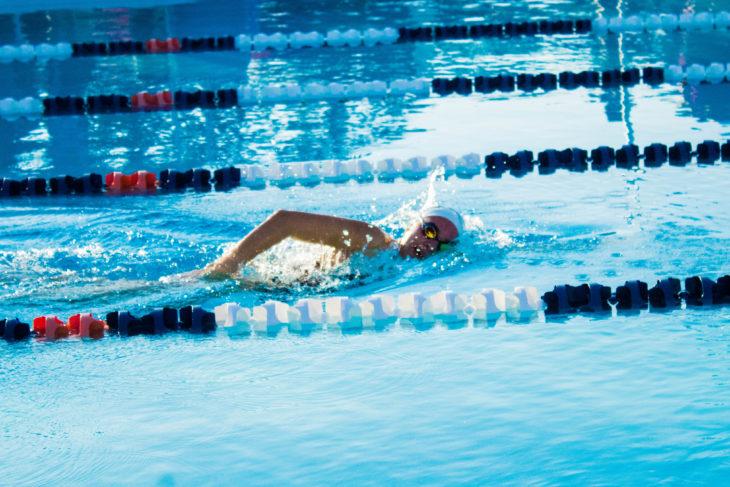 Oklahoma Christian swimmer races towards the finish. Photo by Jenny Rigney