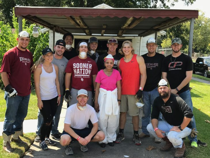 Houston home owner poses with members of the Oklahoma Christian baseball team during the Hurricane Harvey relief efforts. Photo by Hayden Strobel.