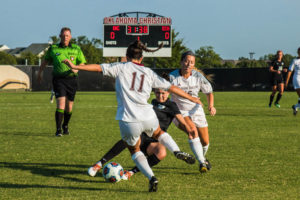 Eagles and Lady Eagles fight through another week of the season. Photo by Jenny Rigney.
