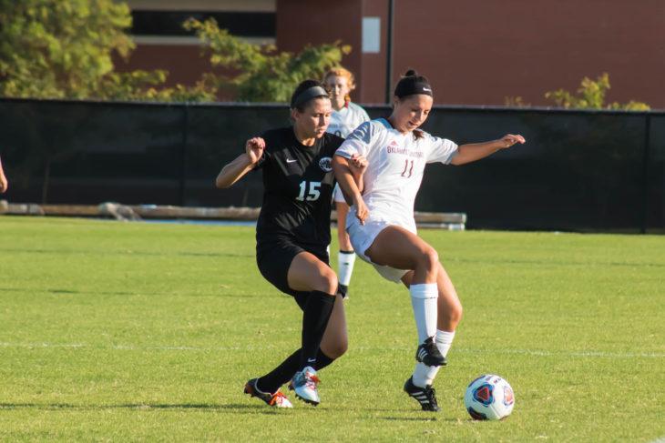 Sophomore Dakota Milner gains possession against an East Central defender in the 1-0 win on Thursday. Photo by Jenny Rigney.