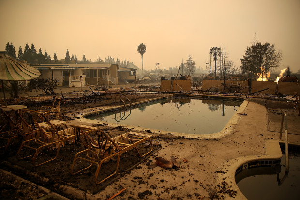 SANTA ROSA, CA - OCTOBER 09:  Burned lawn chairs sit next to the swimming pool at the Journey's End Mobile Home Park on October 9, 2017 in Santa Rosa, California. (Photo by Justin Sullivan/Getty Images)