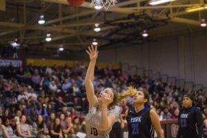Sophomore Megan Shelton goes up for a layup. Photo by Jenny Rigney.