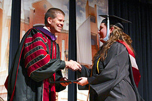 Graduating seniors will walk the Hardeman Auditorium stage Dec. 15. Online photo.