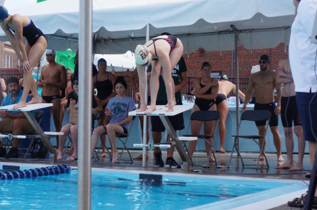 Swim teams close regular season at edmond ice breaker meet talon news for Rocky mountain house swimming pool schedule